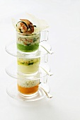 Three kinds of vegetable puree with crayfish in stacked cups