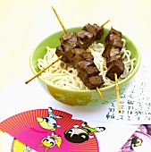 Noodles with meat skewers
