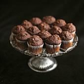Mini chocolate muffins on a pedestal cake stand