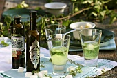 Three glasses of absinthe with iced water