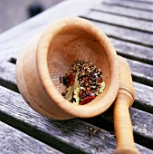 Assorted spices in a wooden mortar