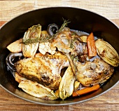 Pheasant with vegetables in braising pan