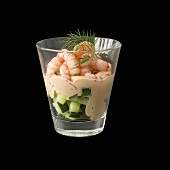 Shrimp cocktail on diced cucumber in glass