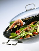 Asian vegetables and prawns in wok