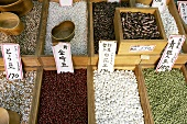 Various types of beans on a market stall in Japan