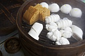 Various types of Chinese dumplings in steaming basket