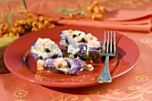 Baked purple potatoes with pumpkin and cheese filling