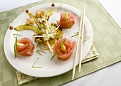 Asian appetiser with tuna rolls