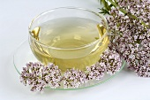 Valerian tea in glass cup with flowers