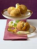Fried apple dumplings with grape must and cream sauce