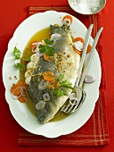 Stuffed carp in vegetable stock