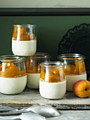 Panna cotta with apricot compote in glasses