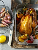 Roast guinea fowl with lemons and shallots