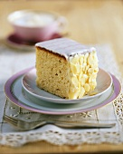 A piece of iced almond cake