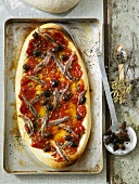 Pizza siciliana (Pizza topped with anchovies, capers & olives)
