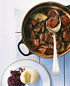 Hare ragout with bacon and onions