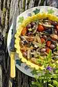 Tomato, mushroom and olive tart with cornmeal crust