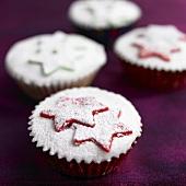 Christmas cupcakes with marzipan stars and icing sugar