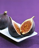 One whole and one halved fig