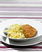 Breaded escalope with white cabbage salad