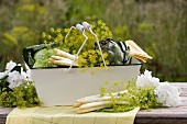 Dill, asparagus, savoy cabbage & artichoke in metal basket