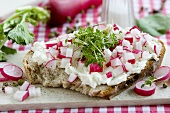 Farmhouse bread topped with soft cheese, radishes, cress & pepper