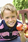 Boy with a bitten apple in his hand