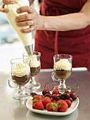 Decorating chocolate cream with cream topping