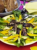Vegetable salad with beef and balsamic dressing