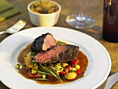 Lamb fillet with bean salad and potato & courgette gratin