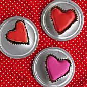 Three heart-shaped iced cakes