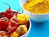 Peppers and turmeric in two small bowls