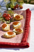 Crusty baguette slices topped with soft cheese & rose hip puree
