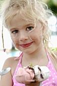 Blond girl with an ice cream sundae