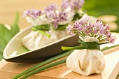 Rice paper purses with soft cheese filling and chives