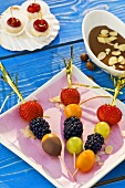 Skewered berries with chocolate sauce