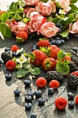 Fresh berries with bunch of roses