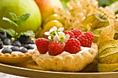 Two berry tarts in a fruit bowl