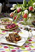 Rosemary-studded leg of lamb with vegetables