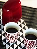 Two beakers of coffee