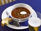 Goulash soup with crème fraîche and white bread