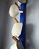 Sieves and funnels hanging on wall pegs