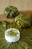 Wrapping goat's cheese in vine leaves