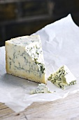 A piece of Stilton on greaseproof paper