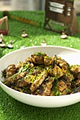 Spicy chicken wings in a dish