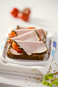 Ham with mustard crust and tomatoes on wholemeal bread
