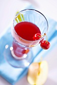 Apple and cherry juice in glass