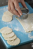 Cutting out pastry circles for mince pies