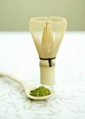 Matcha tea (powdered green tea, Japan) with tea whisk
