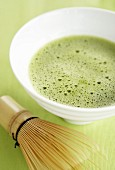 Bowl of matcha tea and tea whisk (Japan)